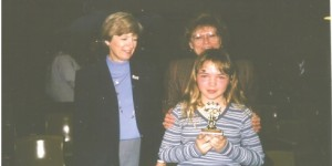In the sixth grade, Mallory competed in the spelling bee at Lincoln Elementary and was the champion of the whole school.  Next, she competed in the district contest which included middle school students.  Mallory was an excellent speller and well prepared when the big night arrived.  Word after word she spelled correctly and competitor after competitor dropped by the wayside.  There were just three contestants left and they competed for 23 rounds.  She was finally eliminated when she misspelled the word, ostensible.  This word became infamous in our family.  Mallory can be seen smiling for the camera with her teacher, Mrs. Martin and the principal.  Her eyes are swollen from crying; she was devastated.  Mrs. Martin wrote about Mallory's great accomplishment in the school newspaper.  Mama and Daddy were also very proud of her!